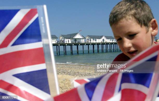 Gareth Collings age 8 from Southwold makes a sandcastle close to the first seaside pier to be built in Britain for nearly half a century which...