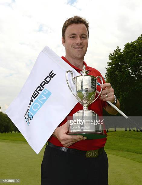 Gareth Davies of Abbeydale Golf Club poses with the trophy after winning the Powerde PGA Assistants' Championship Final at The Coventry Golf Club on...
