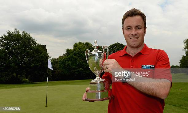 Gareth Davies of Abbeydale Golf Club poses with the trophy after winning the Powerade PGA Assistants' Championship Final at The Coventry Golf Club on...