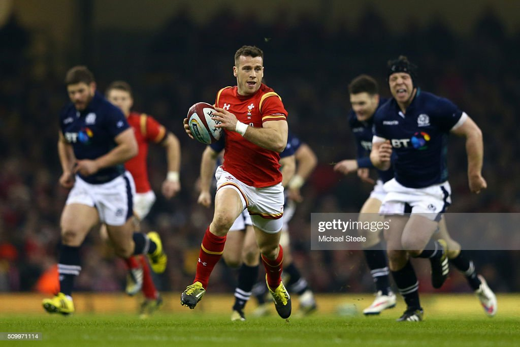Gareth Davies of Wales breaks away to score the opening try during the RBS Six Nations match between Wales and Scotland at the Principality Stadium on February 13, 2016 in Cardiff, Wales.