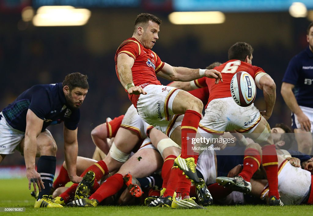 Gareth Davies of Wales clears the ball from a ruck during the RBS Six Nations match between Wales and Scotland at the Principality Stadium on February 13, 2016 in Cardiff, Wales.