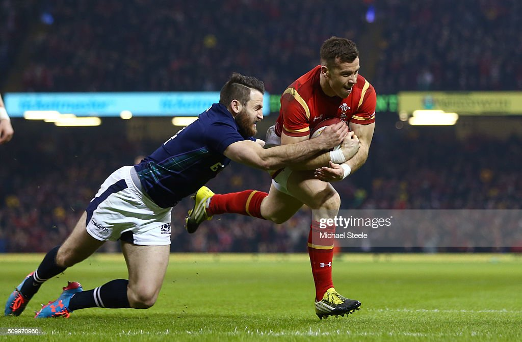 Gareth Davies of Wales goes through the tackle from <a gi-track='captionPersonalityLinkClicked' href=/galleries/search?phrase=Tommy+Seymour&family=editorial&specificpeople=8797212 ng-click='$event.stopPropagation()'>Tommy Seymour</a> of Scotland to score the opening try during the RBS Six Nations match between Wales and Scotland at the Principality Stadium on February 13, 2016 in Cardiff, Wales.