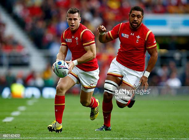 Gareth Davies of Wales makes a break with Taulupe Faletau during the 2015 Rugby World Cup Pool A match between Australia and Wales at Twickenham...