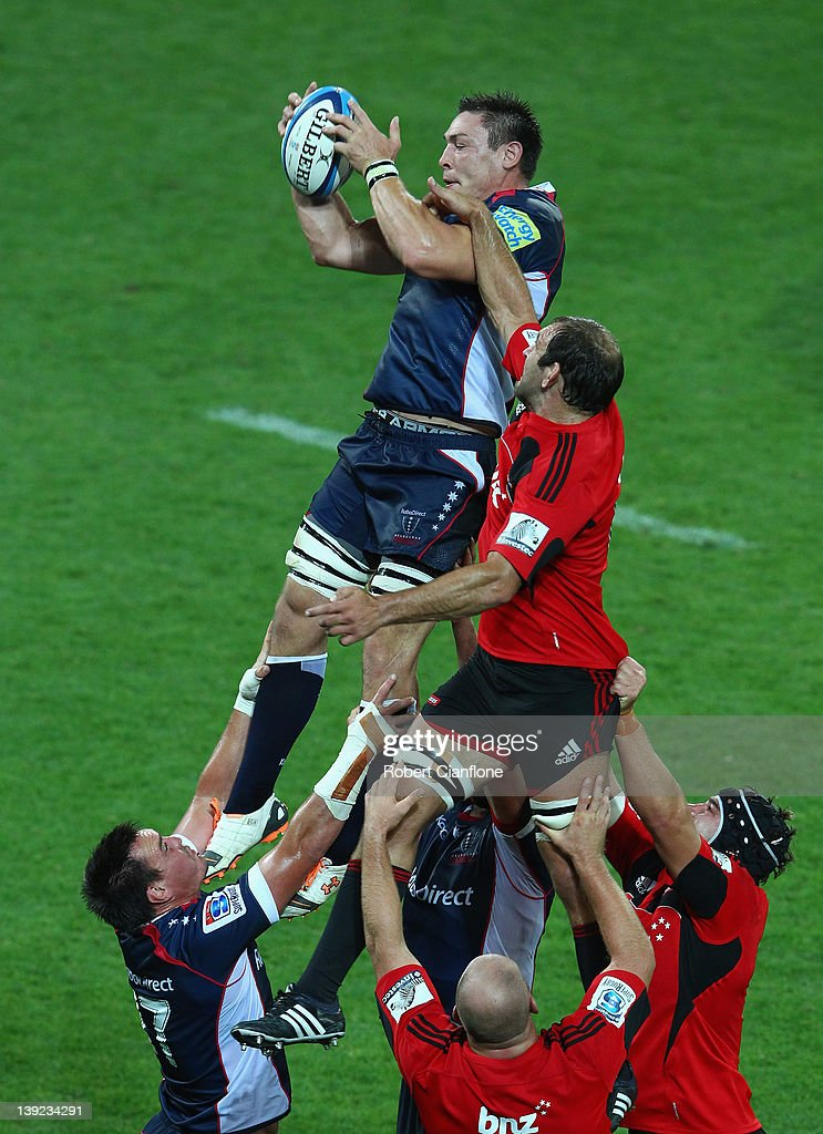 <a gi-track='captionPersonalityLinkClicked' href=/galleries/search?phrase=Gareth+Delve&family=editorial&specificpeople=697704 ng-click='$event.stopPropagation()'>Gareth Delve</a> of the Rebels is challenged by <a gi-track='captionPersonalityLinkClicked' href=/galleries/search?phrase=George+Whitelock&family=editorial&specificpeople=4532140 ng-click='$event.stopPropagation()'>George Whitelock</a> of the Crusaders during the Super Rugby trial match between the Melbourne Rebels and the Crusaders at AAMI Park on February 18, 2012 in Melbourne, Australia.