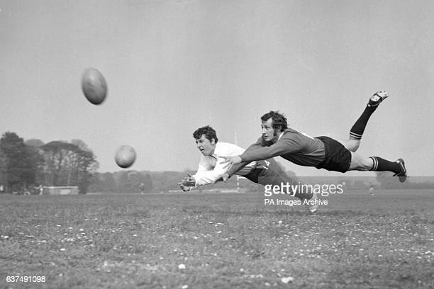 Gareth Edwards and Ray Hopkins fly through the air as the British Lions rugby team train at Eastbourne before their tour of Australia New Zealand and...