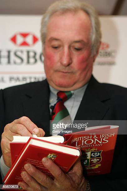 Gareth Edwards signs autographs during an Audience with HSBC British Lions Ambassadors Gareth Edwards and John Smit at the Millennium Stadium on...