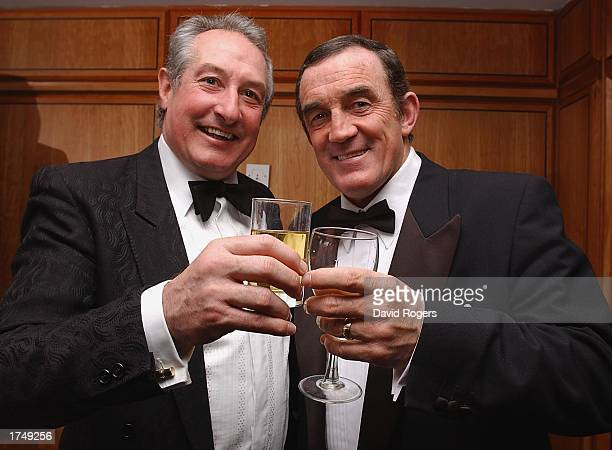 Gareth Edwards with Phil Bennett the Barbarian halfback pairs raise their glasses during the reunion party for the 1973 Barbarians held at the Hilton...