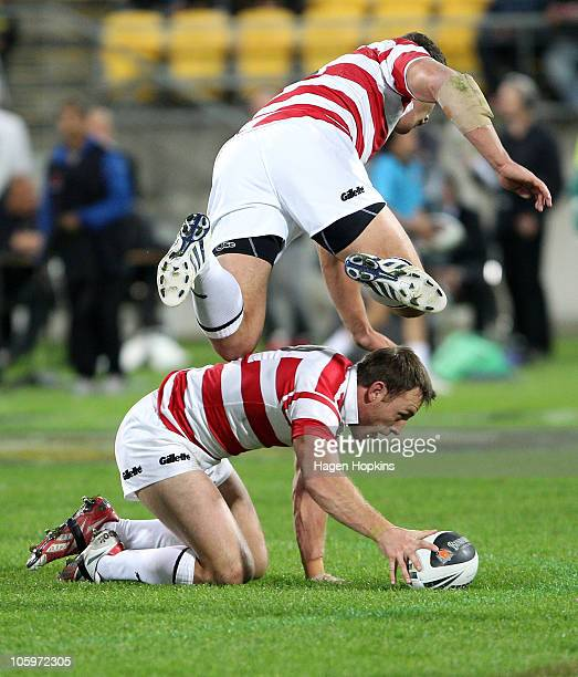 Gareth Ellis of England flies over teammate James Roby during the Four Nations match between the New Zealand Kiwis and England at Westpac Stadium on...