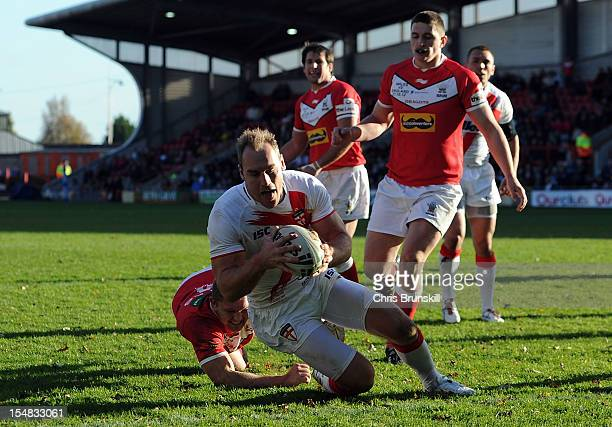 Gareth Ellis of England goes over for a try during the International Match between Wales and England at Racecourse Ground on October 27 2012 in...
