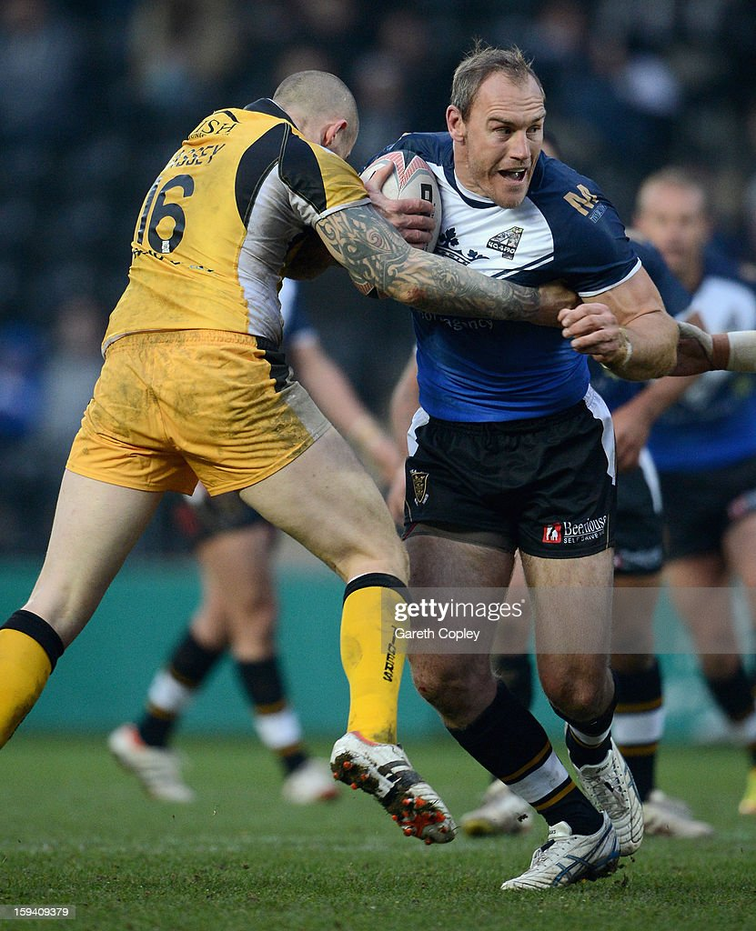 Gareth Ellis of Hull FC is tackled by Nathan Massey of Castleford during a pre-season friendly match between Hull FC and Castleford Tigers at The KC Stadium on January 13, 2013 in Hull, England.