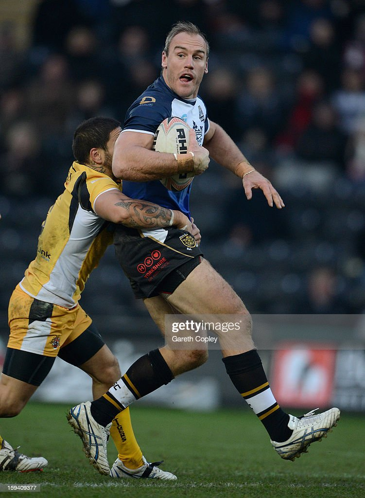 Gareth Ellis of Hull FC is tackled by Rangi Chase of Castleford during a pre-season friendly match between Hull FC and Castleford Tigers at The KC Stadium on January 13, 2013 in Hull, England.