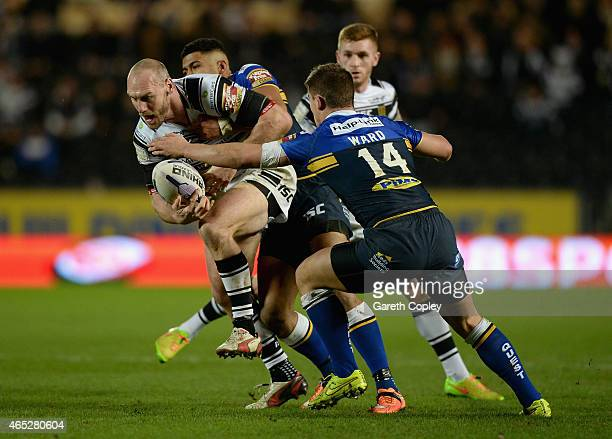 Gareth Ellis of Hull FC is tackled by Stevie Ward of Leeds Rhinos during the First Utility Super League match between Hull FC and Leeds Rhinos at KC...
