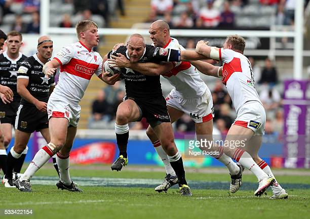 Gareth Ellis of Hull FC tackled by Mitch Allgood Graeme Horne and Dane Tilse of Hull KR during the First Utility Super League match between Hull FC...