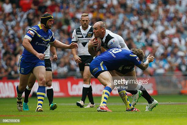 Gareth Ellis of Hull FC tries to break through a tackle by Ashton Sims of Warrington Wolves during the Ladbrokes Challenge Cup Final between Hull FC...