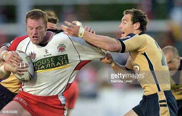 Gareth Ellis of Leeds tackles Craig Stapleton of Leeds during the Engage Super League match between Leigh Centurions and Leeds Rhinos at the Coliseum...