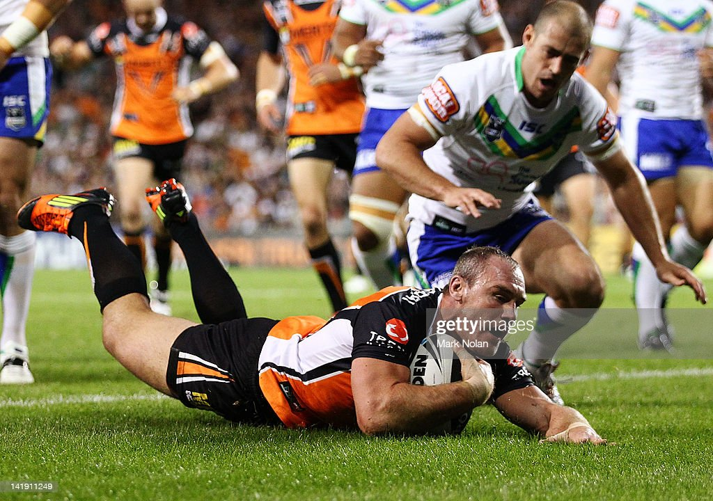 Gareth Ellis of the Tigers scores during the round four NRL match between the Wests Tigers and the Canberra Raiders at Campbelltown Sports Stadium on March 26, 2012 in Sydney, Australia.
