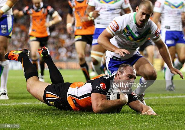 Gareth Ellis of the Tigers scores during the round four NRL match between the Wests Tigers and the Canberra Raiders at Campbelltown Sports Stadium on...