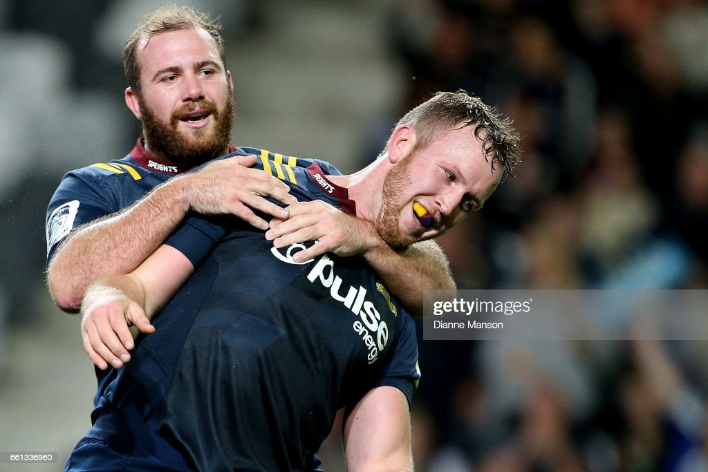 Gareth Evans (R) celebrates his try with team mate Greg Pleasants-Tate of the Highlanders celebrates his try during the round six Super Rugby match between the Highlanders and the Rebels at Forsyth Barr Stadium on March 31, 2017 in Dunedin, New Zealand.