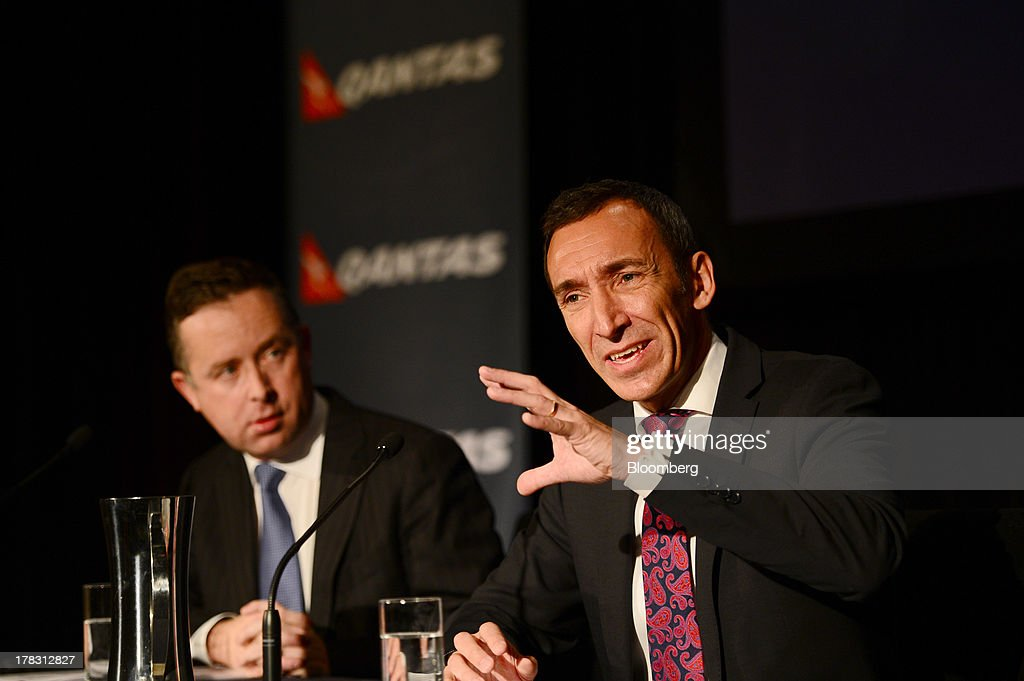 Gareth Evans, chief financial officer, right, speaks as Alan Joyce, chief executive officer of Qantas Airways Ltd. looks on during a news conference in Sydney, Australia, on Thursday, Aug. 29, 2013. Qantas, Australia's largest carrier, doubled its profits and beat analyst estimates as a tie-up with Emirates helped rein in long-haul losses. Its shares rose the most in a year. Photographer: Jeremy Piper/Bloomberg via Getty Images