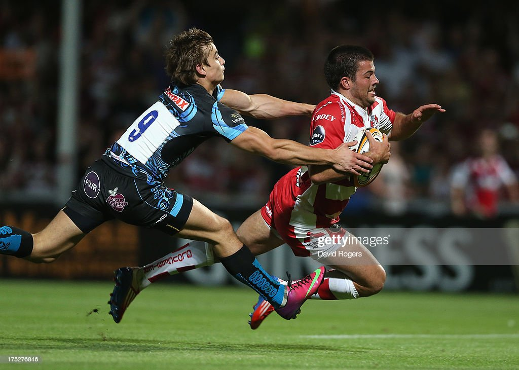 Gareth Evans of Gloucester dives over for a try against Exeter Chiefs during the J.P. Morgan Asset Management Premiership Rugby 7's held at Kingsholm Stadium on August 1, 2013 in Gloucester, England.