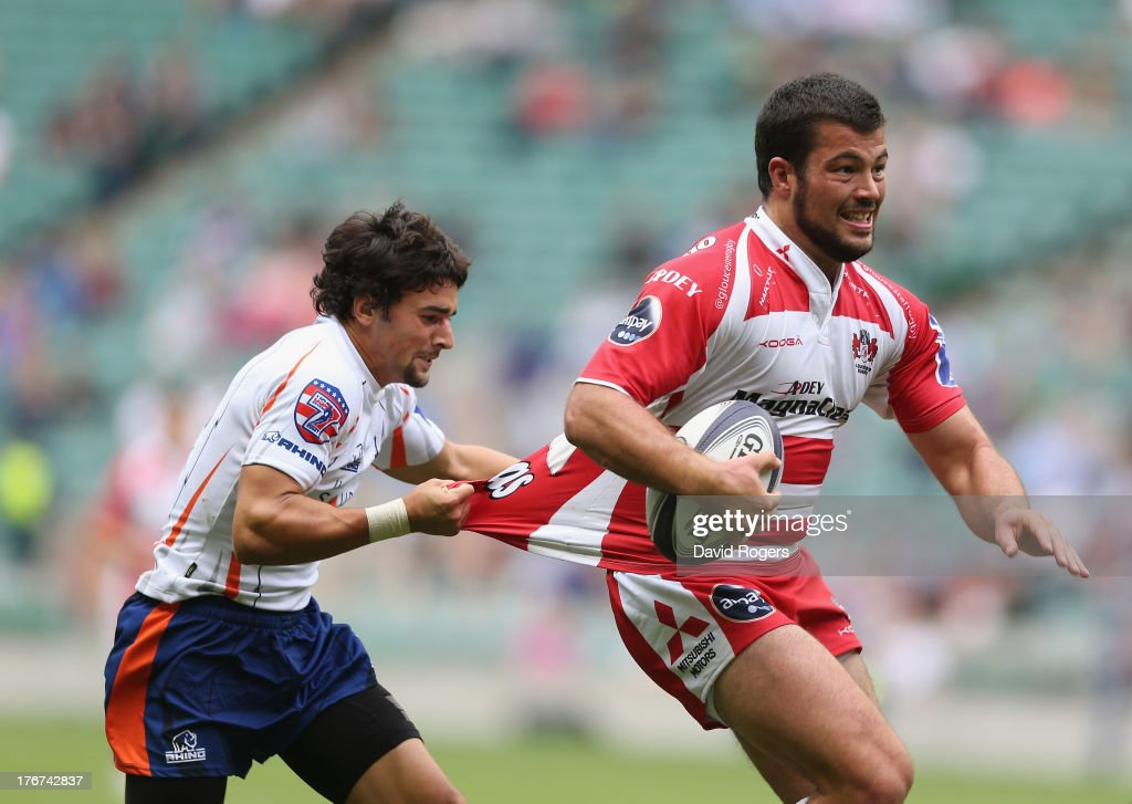 Gareth Evans of Gloucester is tackled by Nate Augspurger of New York in the Plate final during the World Club 7's at Twickenham Stadium on August 18, 2013 in London, England.