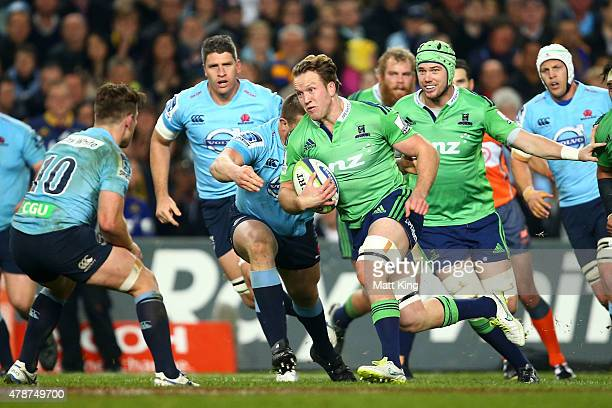 Gareth Evans of the Highlanders runs with the ball during the Super Rugby Semi Final match between the Waratahs and the Highlanders at Allianz...