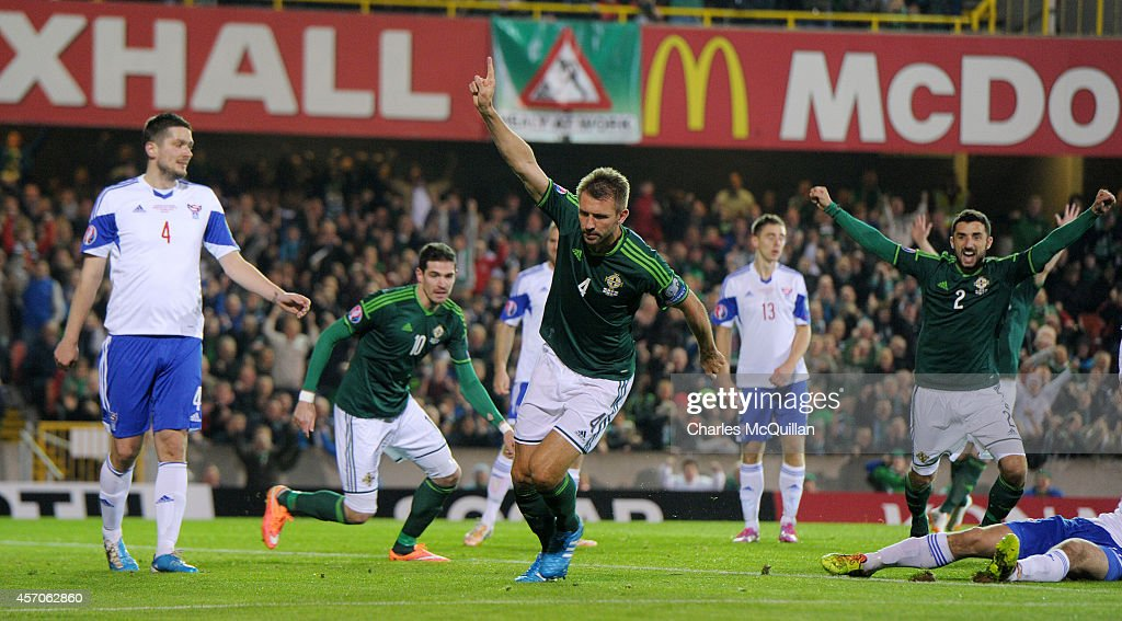 Gareth McAluey celebrates after opening the scoring during the EURO 2016 Qualifier between Northern Ireland and Faroe Islands at Windsor Park on...