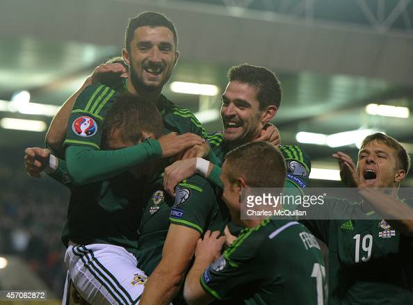 Gareth McAluey is mobbed by teammates as he celebrates after opening the scoring during the EURO 2016 Qualifier between Northern Ireland and Faroe...