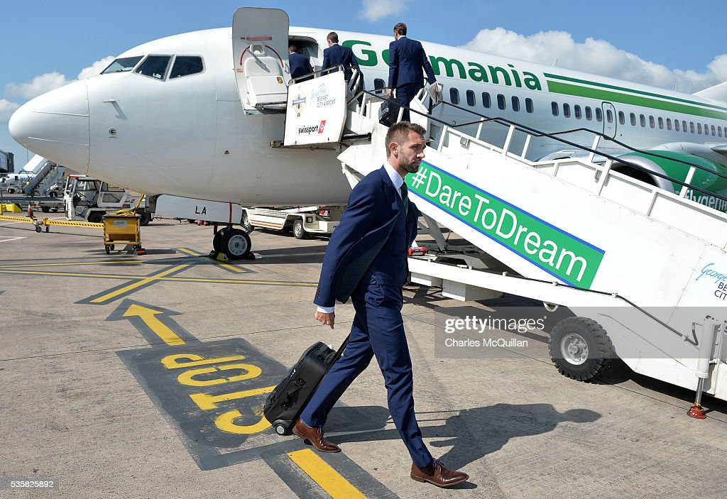 Gareth McAuley makes his way on to the plane before Northern Ireland's training camp departure at George Best City Airport on May 30, 2016 in Belfast, Northern Ireland. Northern Ireland have qualified for the Euro 2016 football championship finals in France, the first time the province has qualified for an international football tournament final since 1986.