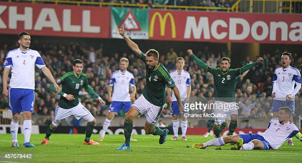 Gareth McAuley of Northern Ireland celebrates after scoring his teams first goal during the Euro 2016 Qualifier between Northern Ireland and Faroe...