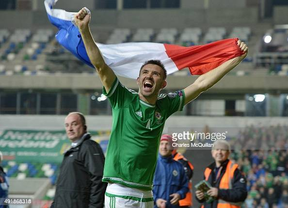 Gareth McAuley of Northern Ireland celebrates after this evenings Euro 2016 Group F international football match at Windsor Park on October 8 2015 in...