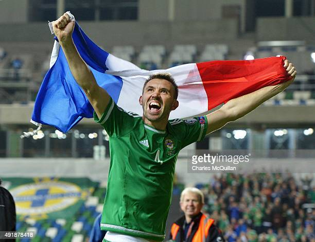 Gareth McAuley of Northern Ireland celebrates clinching qualification after the UEFA EURO 2016 qualifier between Northern Ireland and Greece at...