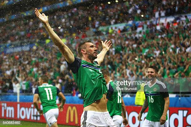 Gareth McAuley of Northern Ireland celebrates scoring his team's first goal during the UEFA EURO 2016 Group C match between Ukraine and Northern...