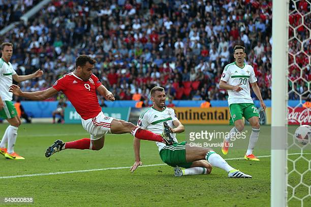 Gareth McAuley of Northern Ireland scores an own goal during the UEFA Euro 2016 Round of 16 match between Wales and Northern Ireland at Parc des...