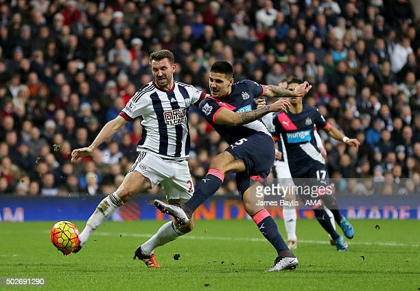 Gareth McAuley of West Bromwich Albion and Aleksandar Mitrovic of Newcastle United during the Barclays Premier League match between West Bromwich...