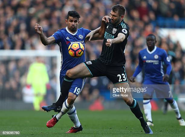 Gareth McAuley of West Bromwich Albion and Diego Costa of Chelsea compete for the ball during the Premier League match between Chelsea and West...