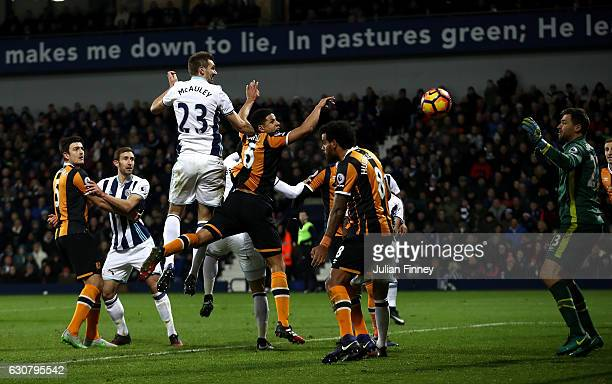 Gareth McAuley of West Bromwich Albion beats Curtis Davies of Hull City to score his sides second goal with a header during the Premier League match...