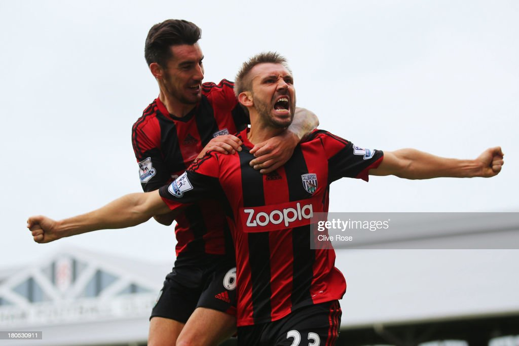 Gareth McAuley (R) of West Bromwich Albion celebrates his goal with <a gi-track='captionPersonalityLinkClicked' href=/galleries/search?phrase=Liam+Ridgewell&family=editorial&specificpeople=227283 ng-click='$event.stopPropagation()'>Liam Ridgewell</a> during the Barclays Premier League match between Fulham and West Bromwich Albion at Craven Cottage on September 14, 2013 in London, England.