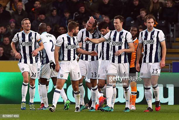 Gareth McAuley of West Bromwich Albion celebrates scoring the opening goal with his team mates during the Premier League match between Hull City and...