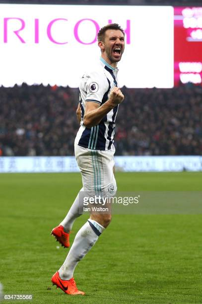 Gareth McAuley of West Bromwich Albion celebrates scoring their second goal to make it 22 during the Premier League match between West Ham United and...