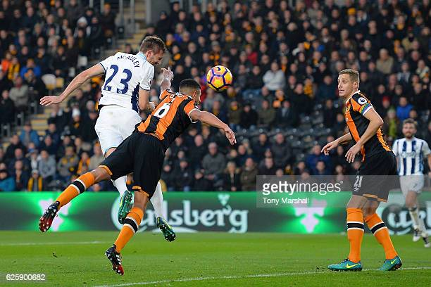 Gareth McAuley of West Bromwich Albion heads to score the opening goal during the Premier League match between Hull City and West Bromwich Albion at...