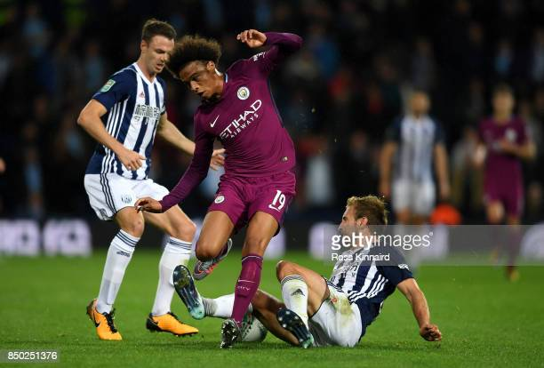 Gareth McAuley of West Bromwich Albion tackles Leroy Sane of Manchester City during the Carabao Cup Third Round match between West Bromwich Albion...