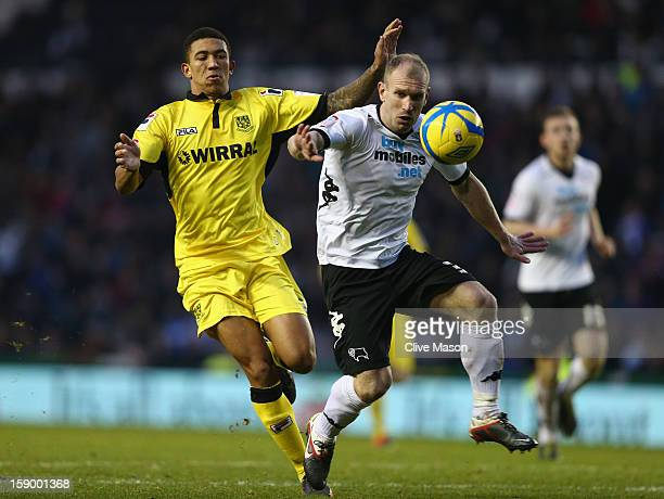 Gareth Roberts of Derby County is challenged by Liam Palmer of Tranmere Rovers during the FA Cup with Budweiser Third Round match between Derby...