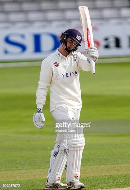 Gareth Roderick of Gloucestershire raises his bat and celebrates scoring a half century during the Specsavers County Championship match between Essex...