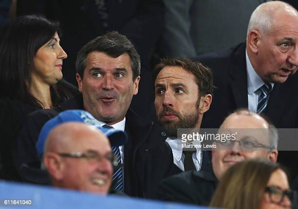 Gareth Southgate caretaker manager of England and Roy Keane assistant manager of the Republic of Ireland look on from the stand prior to the Premier...