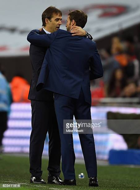 Gareth Southgate interim manager of England and Julen Lopetegui head coach of Spain embrace after the international friendly match between England...