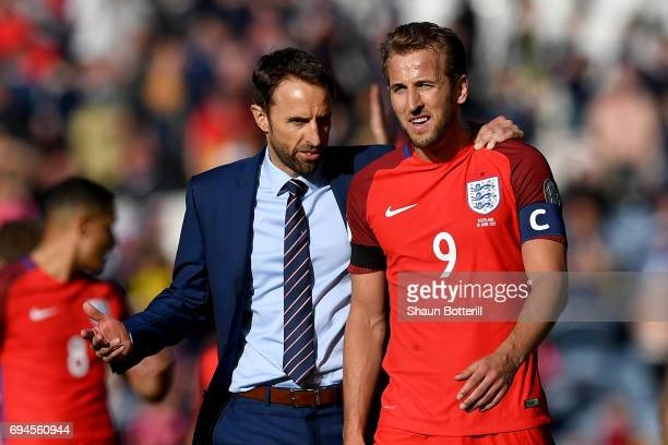 Gareth Southgate Manager of England and Harry Kane of England speak to each other after the FIFA 2018 World Cup Qualifier between Scotland and...