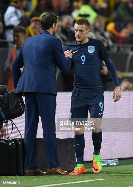 Gareth Southgate Manager of England and Jamie Vardy of England shake hands during the international friendly match between Germany and England at...
