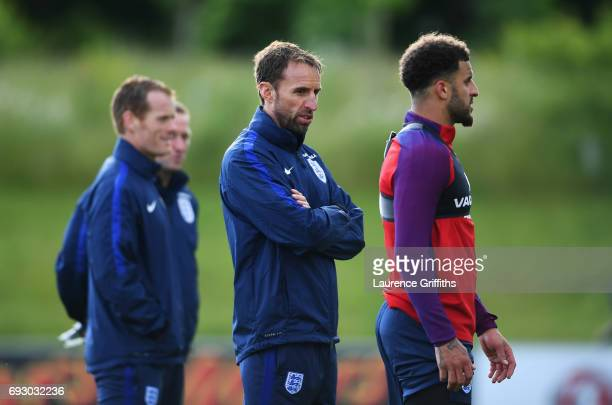 Gareth Southgate manager of England and Kyle Walker look on during a training session as part of England media access at St George's Park on June 6...