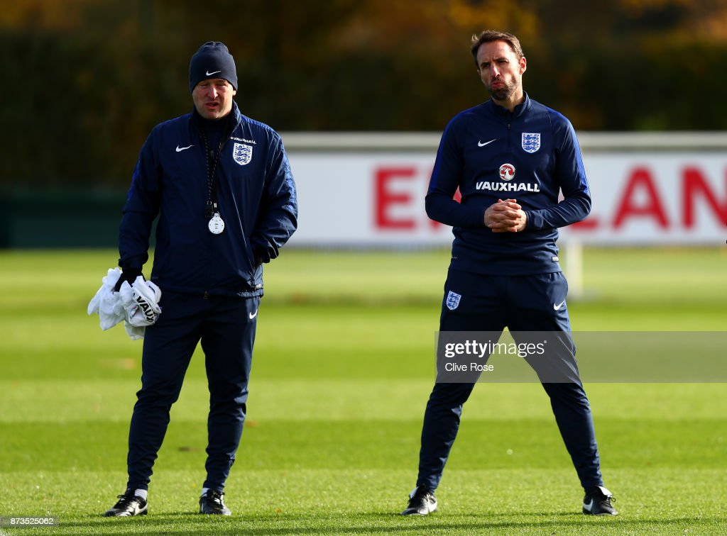 Gareth Southgate (R), Manager of England looks on during an England training session ahead of the International Friendly match between England and Brazil on November 13, 2017 in Enfield, England.
